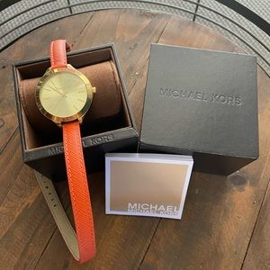 Michael Kors wrap around watch in gold and orange